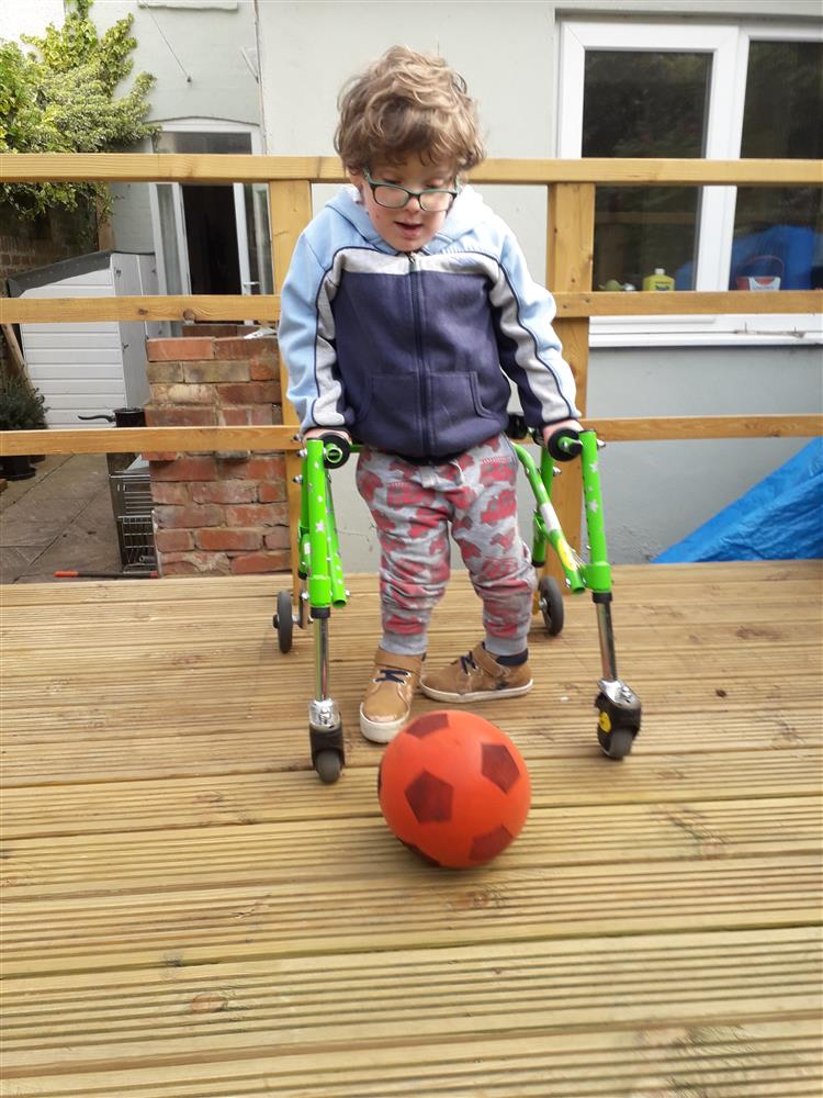 Frank Mills, 6, struggles to walk short distances