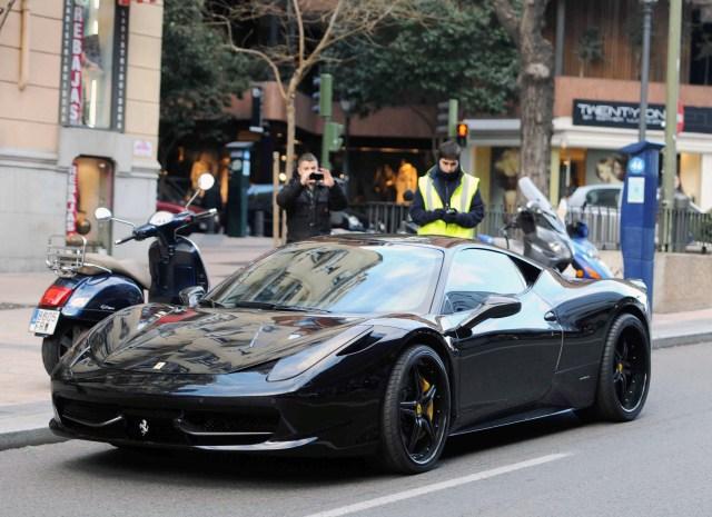 Ozil has also been seen in a £200k Ferrari 458 Italia