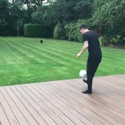 Ozil often ventures out into his sprawling garden and performs kick-ups