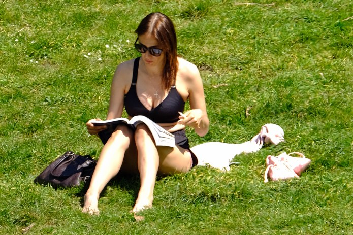 A young woman absorbed the rays at Hyde Park yesterday afternoon