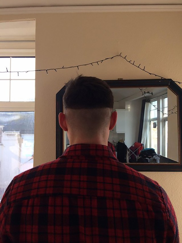 This man sports a perfectly aligned helmet-like hair cut