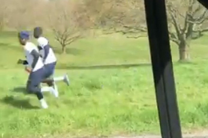 The Tottenham pair was captured by video jogging by a car on the nearby green