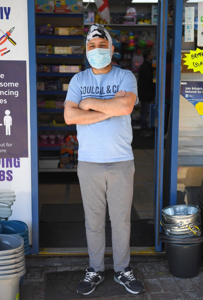 Nirpal Singh stands outside his store in the Little Hulton Mall