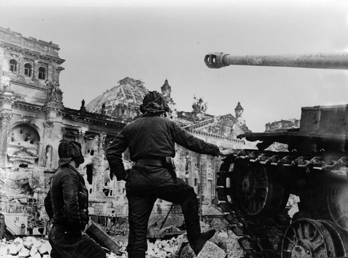 A Soviet tank faces the badly damaged Reichstag building in Berlin where the last pockets of German resistance are finally destroyed