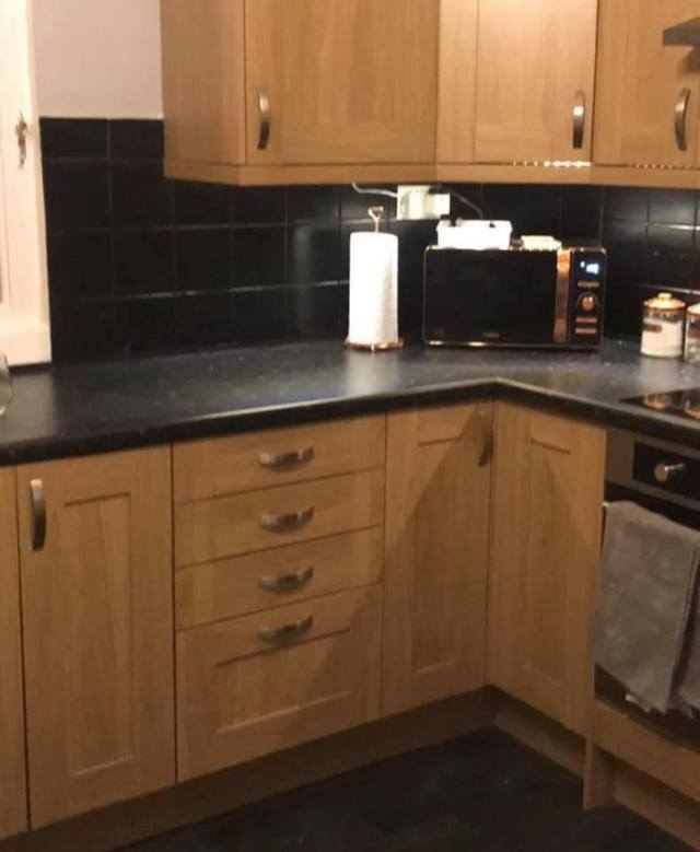 Before the kitchen looked bland and in need of a spruce up - but the woman didn't have a large budget to spend