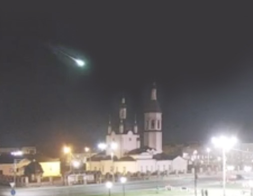 Here the fireball surges across the sky past the roof of the church