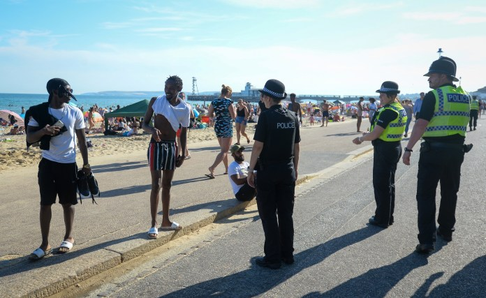 Police patrolled busy Bournemouth Beach yesterday