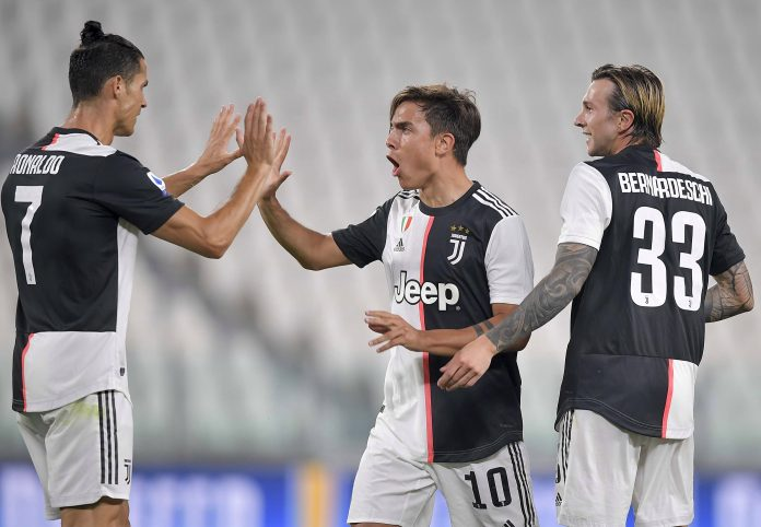 Paulo Dybala of Juventus celebrates after scoring his team's first goal with Cristiano Ronaldo and Federico Bernardeschi