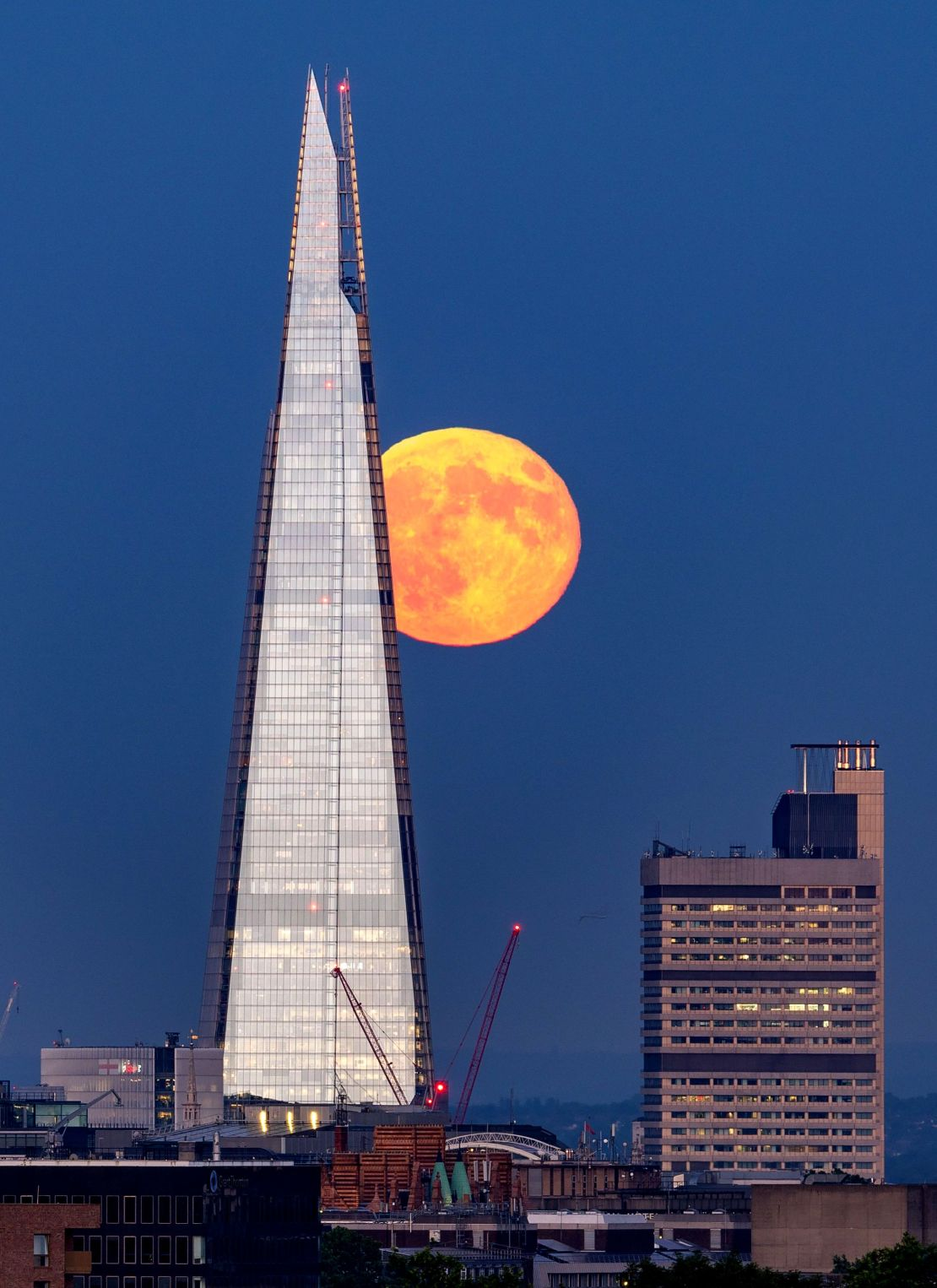 A Strawberry Moon near London's Shard building