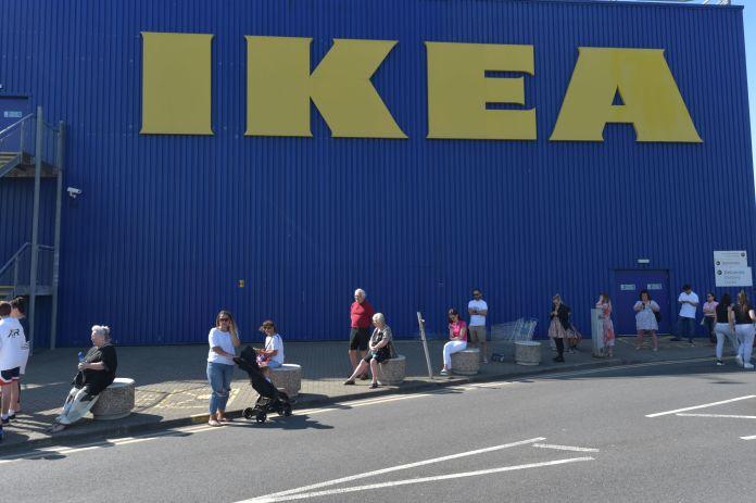 Customers wait to get inside Ikea in Lakeside, Essex