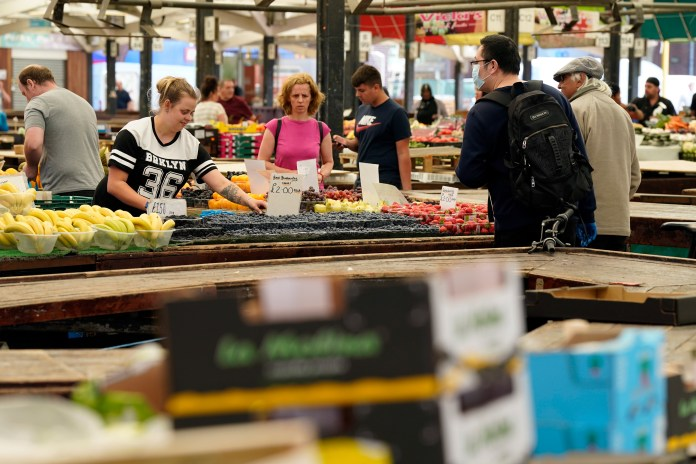 People shopping at leicester market