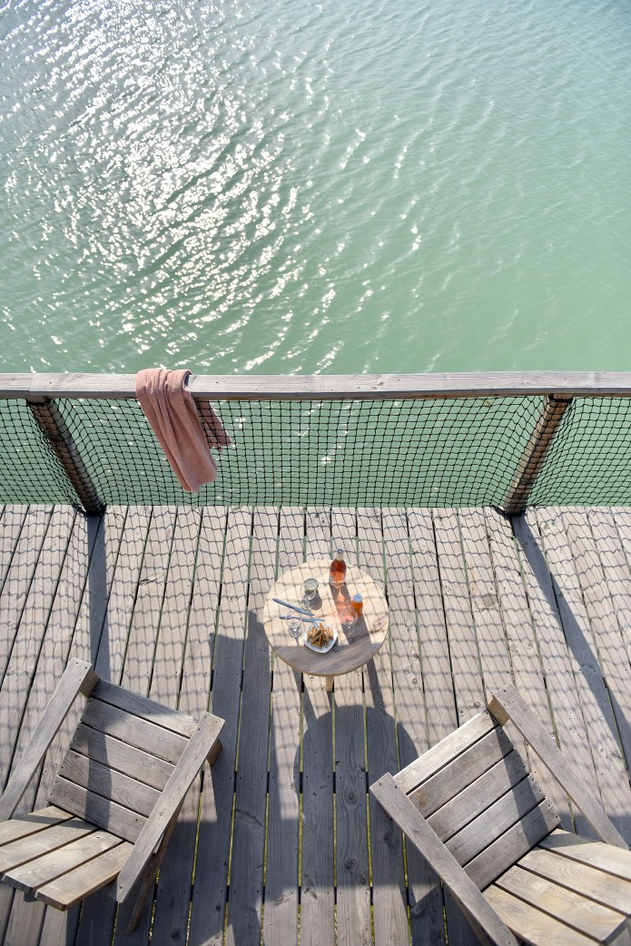Each cabin has a hammock on stilts integrated into the floor of the terraces