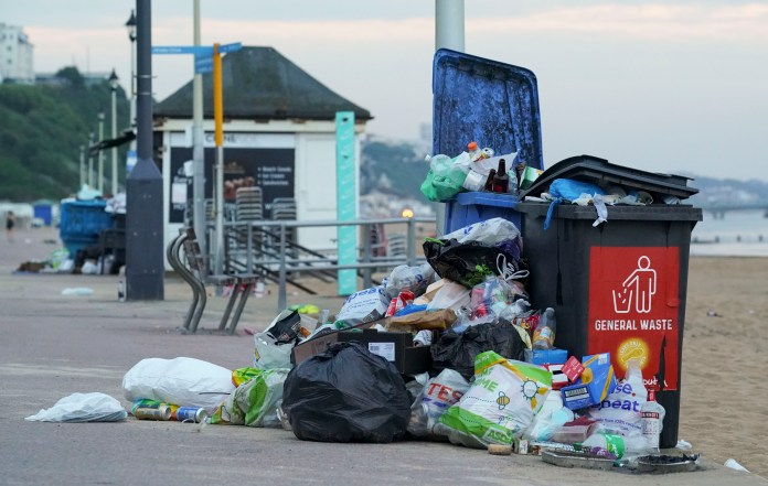 Bins overflowing with waste on Bournemouth Beach