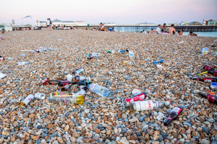 Empty bottles were thrown on Brighton Beach as the hotspot was inundated with crowds yesterday