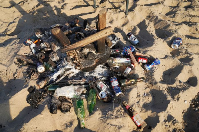 A burnt barbecue was filled with cans of beer on Tynemouth Beach today
