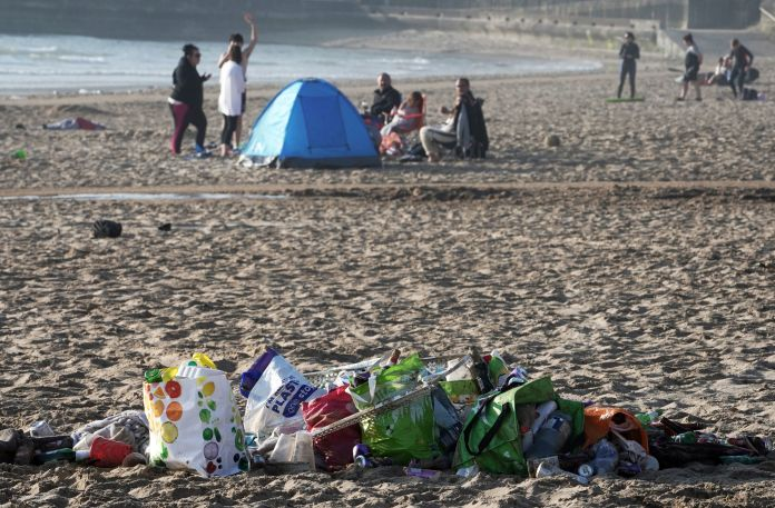 A tent was seen on Tynemouth Beach this morning as piles of litter filled the sand