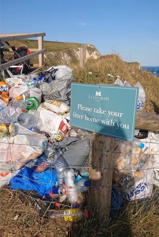 Mountains of rubbish pile up with sign telling vacationers to 'take their rubbish home'
