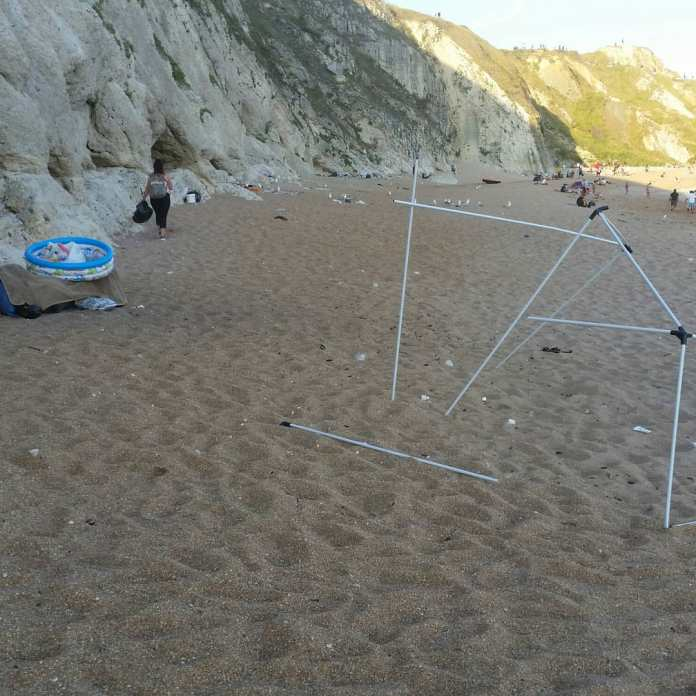 Litter pickers in Dorset collect litter left by beach goers yesterday