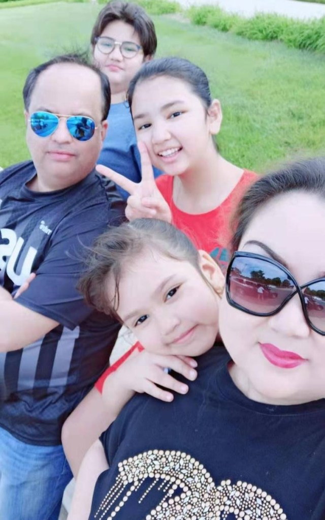 Zumret, now living in the United States with her husband and three kids, smiles with her family in a selfie