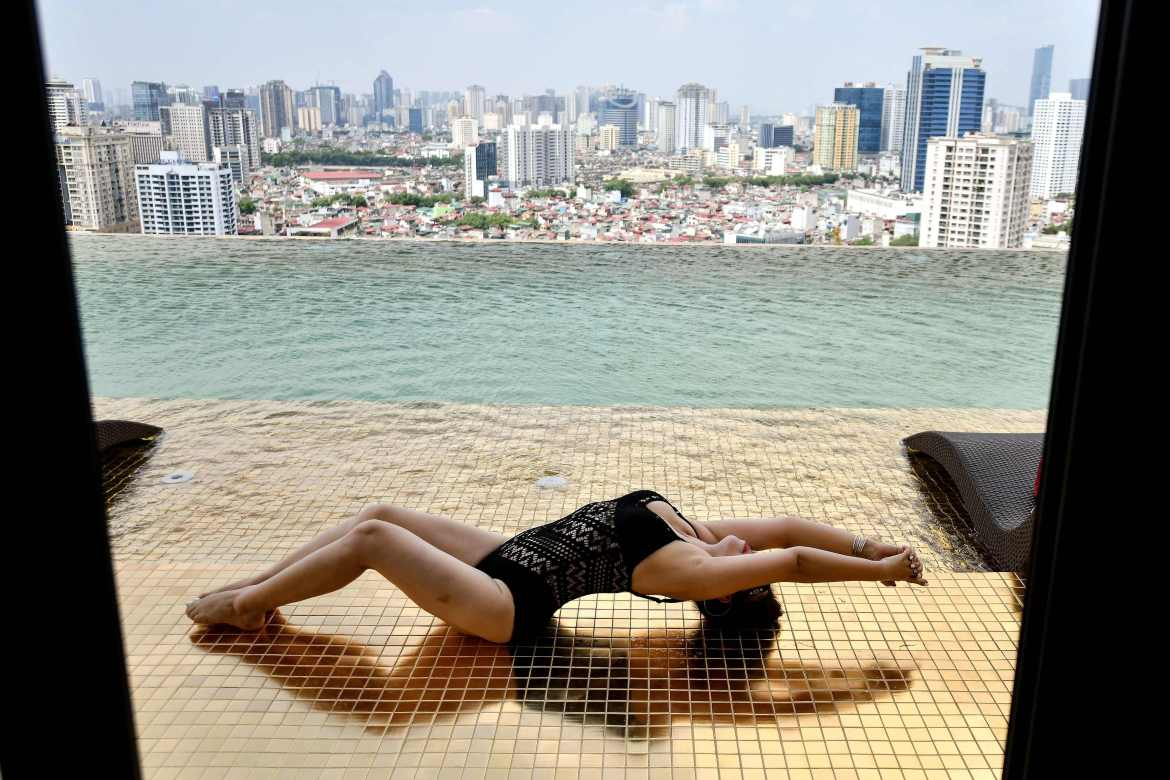 The infinity pool on the hotel's roof is clad in gold tiles