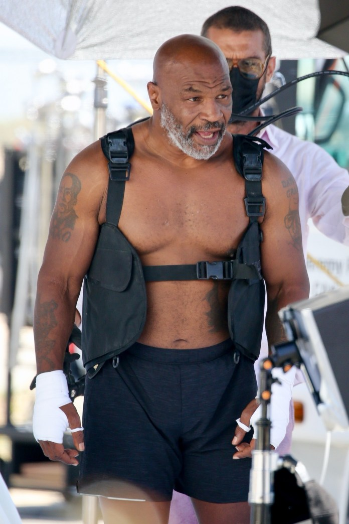 Heavyweight boxing legend, 54, showed off his physique
