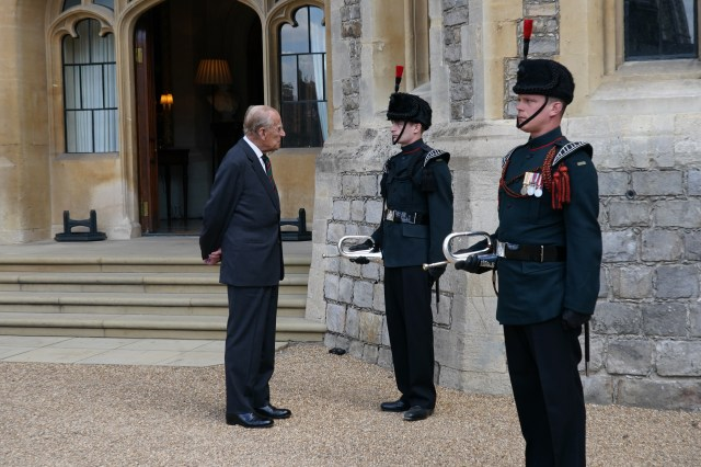 Prince Philip greets buglers at the castle