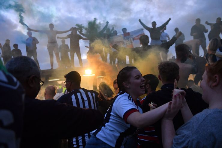 West Brom fans celebrate their team's promotion to the Premier League