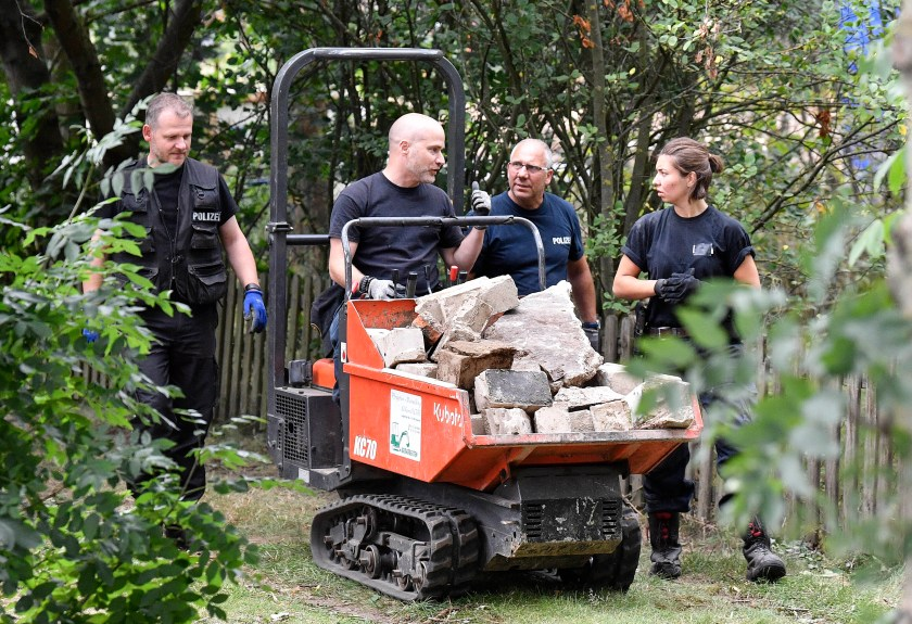 Police removed soil and debris from the site on Wednesday
