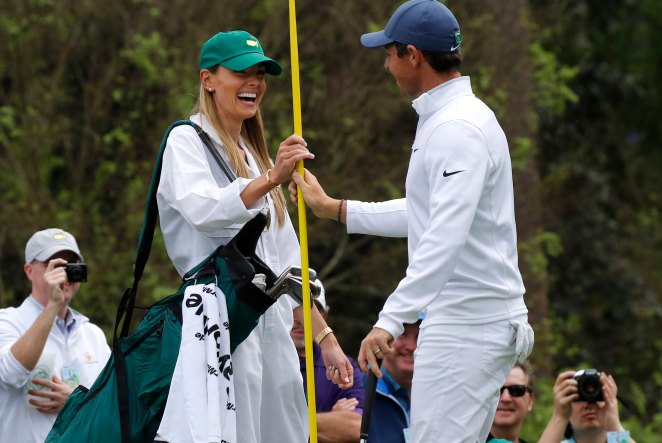 Eric Stoll caddies for her husband Rory McIlroy at Augusta in 2018, 18 months before she fell pregnant