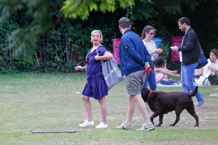 The couple were seen walking Lisa's pet Hurley Labrador