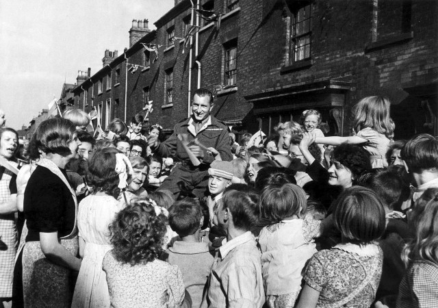 Pte Jim Kavangh, 30, of Edward Street Birmingham could not get home for VJ Day so the children waited until he did return before having their peace day celebration