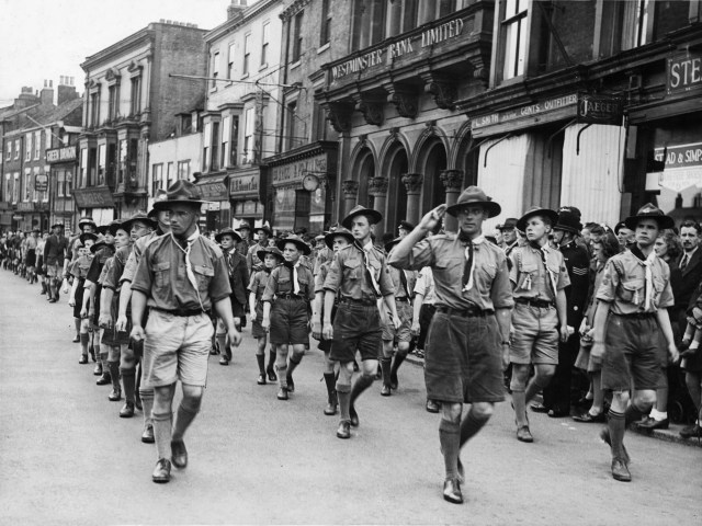 Scouts marching during VJ Day celebrations in England at the end of the Second World War