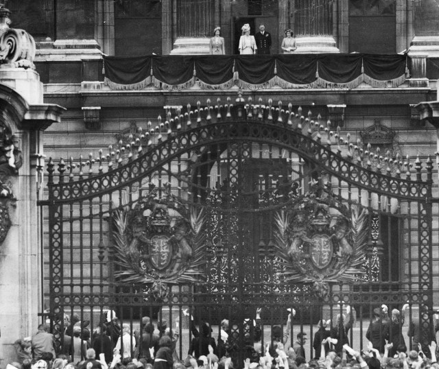 King George VI and Queen Elizabeth, flanked by Princess Elizabeth (far left) and Princess Margaret (far right) on VJ Day, pictured on the balcony of Buckingham Palace in London