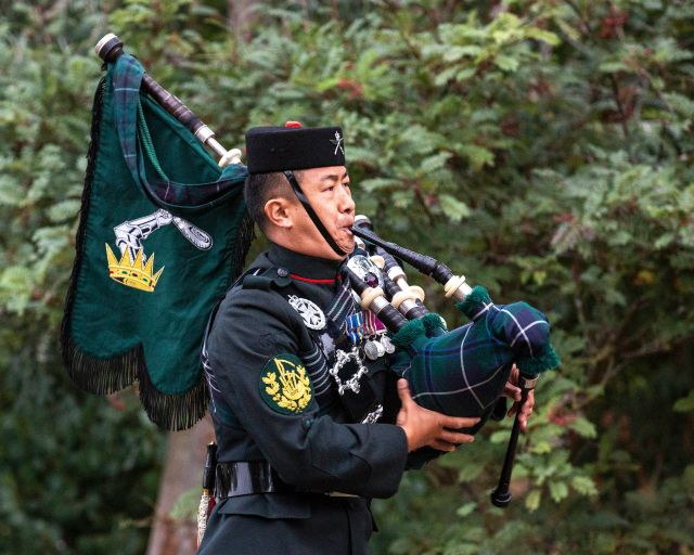 Colour Sergeant Lil Bahadur Gurung playing the pipes at the VJ Day commemorations at the National Memorial Arboretum, Staffordshire