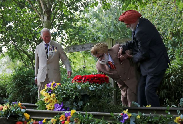The Prince of Wales looks on as WWII veteran Darbara Singh Bhullar, 97, lays a wreath to mark the 75th anniversary of VJ (Victory over Japan) Day