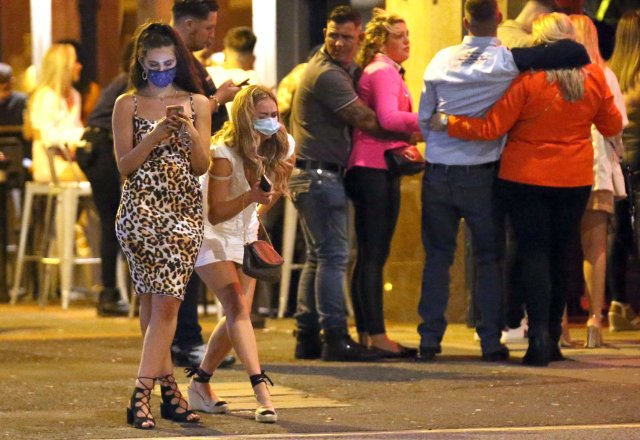 Two girls wearing their masks on a Bank Holiday night out