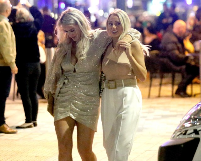 Two blonde friends were seen with their arms around each other as the night went on