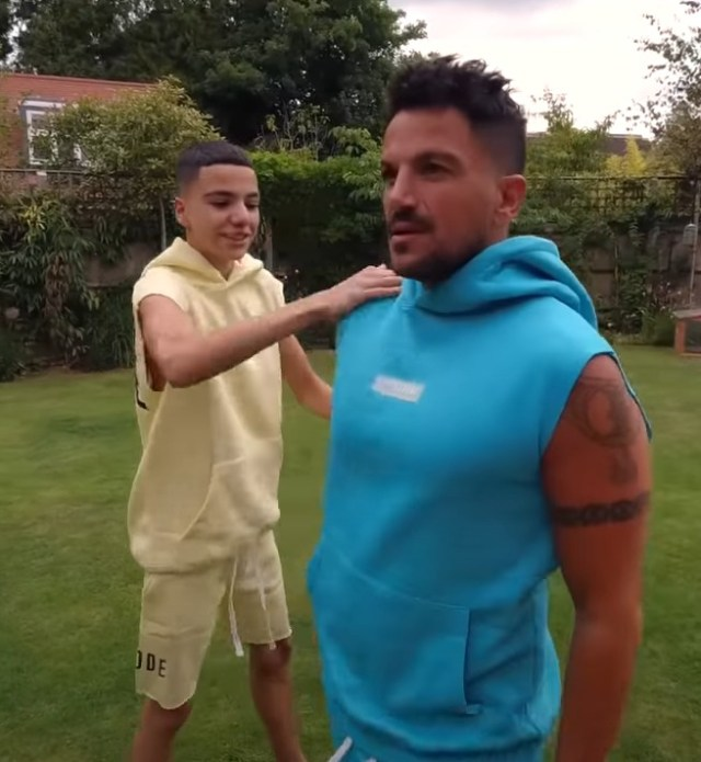 Peter and Junior in matching outfits in the garden on his Sun reality show