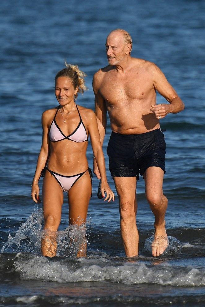 Charles Dance caught they eye in Venice as he took to the sea with a mystery blonde