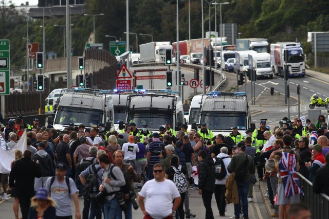 Around 100 anti-migrant protesters blocked the entrance to Dover harbour