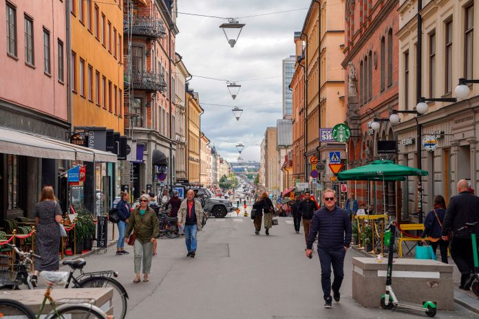 Shoppers walking the streets of Stockholm, Sweden, last month where there are no mandatory coronavirus restrictions in place