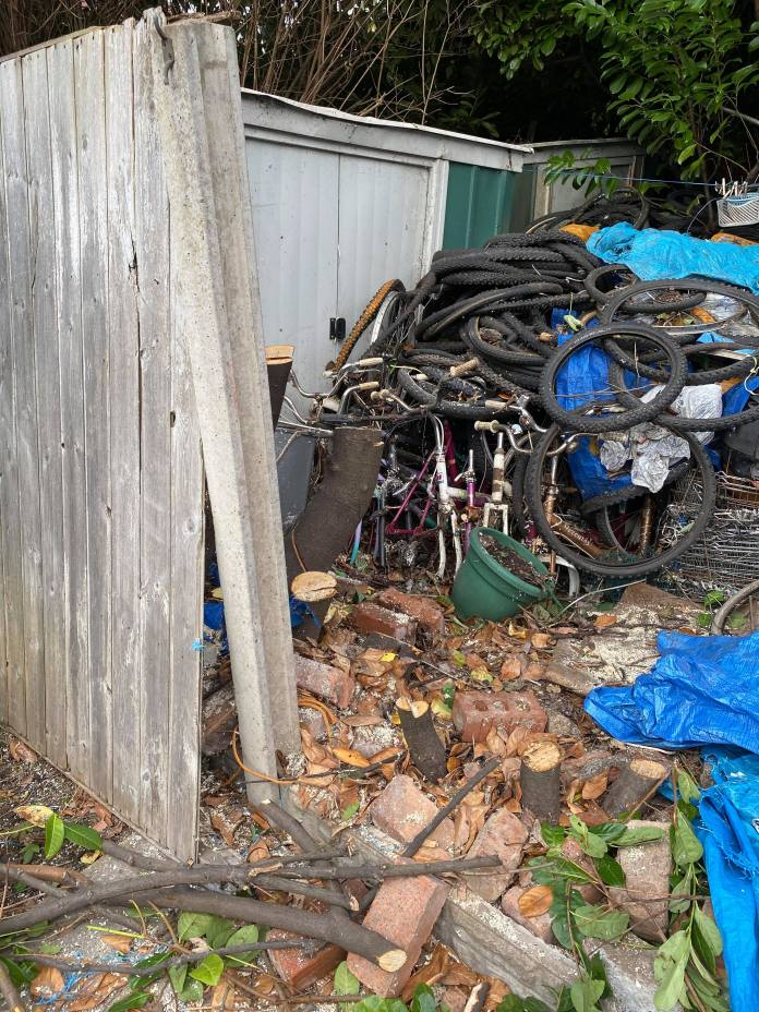 Tires, plastic and even an old fridge were thrown in the pile