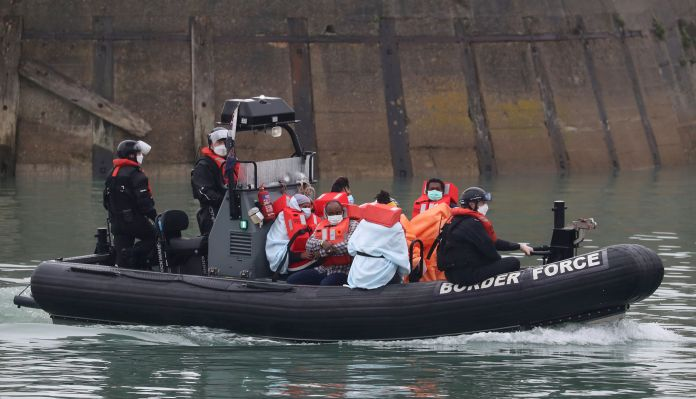 A group of migrants brought to Dover, Kent on Tuesday by border forces