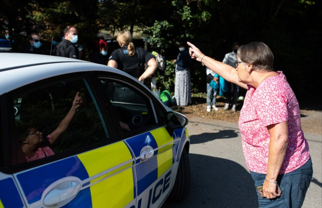 Sue Cook, confronts migrants and police at Kingsdown Beach in Deal
