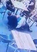 A man in black puts the kidnapper in a body scissors