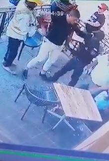 Security helps up the hero who helped stop the kidnapper