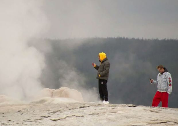 Two arrests were made after tourists took photos too close to a dangerous geyser