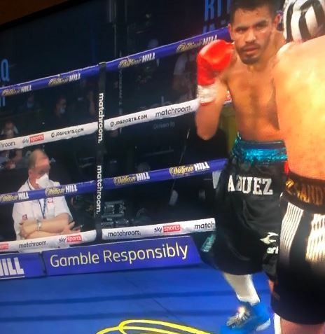 Terry O'Connor is ringside judging Lewis Ritson versus Miguel Vazquez - but his attention seems to be elsewhere