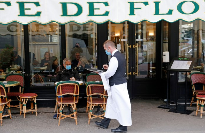 A waiter seen wearing a face mask in a cafe in Paris