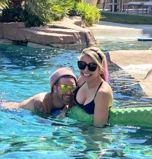 Alexis Bliss cuddled up to boyfriend Ryan Cabrera in a bikini
